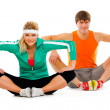 Stock Photo: Fitness young woman and man in sportswear doing stretching exerc