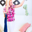 Young woman choosing what to dress — Stock Photo