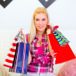 Portrait of young woman with shopping bags — Stock Photo