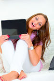 Cheerful lovely woman looking from laptop — Stock Photo