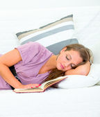 Attractive woman sleeping on sofa at livingroom — Stock Photo