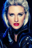 Portrait of beautiful woman in leather jacket. Retouched — Stock Photo