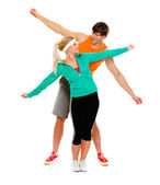 Healthy young female and man in sportswear having fun isolated on white — Stock Photo