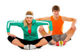 Fitness young woman and man in sportswear doing stretching exerc — Stock Photo