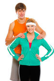 Portrait of happy young man and fitness girl in sportswear isola — Stock Photo