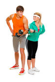 Young man and fitness girl lifting a dumbbell isolated on white — Stock Photo