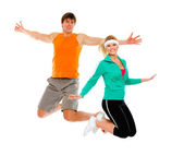 Fitness girl and man in sportswear jumping isolated on white — Stock Photo