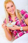 Portrait of pretty woman eating muesli — Stock Photo