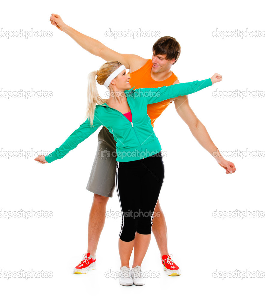 Healthy young female and man in sportswear having fun isolated on white  Stock Photo #8577581