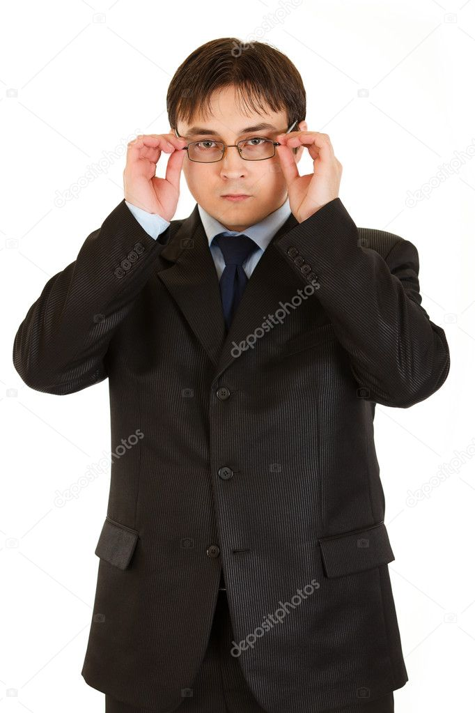 Modern businessman straightening eyeglasses isolated on white — Stock Photo #8578846