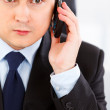 Concentrated businessman talking on mobile phone — Stock Photo #8580480