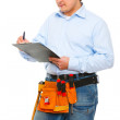Construction worker checking something and writing in clipboard — Stock Photo
