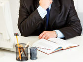 Businessman sitting at office desk with diary. Close-up — Stock Photo