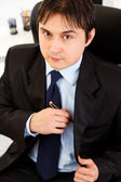 Portrait of successful young businessman at office — Stock Photo