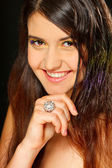 Portrait of beautiful smiling girl with ring on hand — Stock Photo