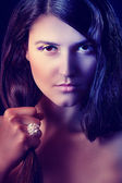 Portrait of beautiful girl with ring on hand. Retouched — Stock Photo