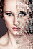 Portrait of tough girl closing face with textile. Retouched — Stock Photo