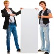 Two modern young men pointing on blank billboard. Isolated on wh — Stock Photo #8604985