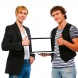 Two happy young men showing laptops blank screen. Isolated on wh — Stock Photo