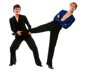 Ballroom male dancer holding leg of his funny posing friend — Stock Photo