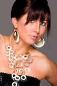 Charming young lady with beautiful jewelry. Retouched — Stock Photo