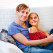 Happy young couple relaxing at home — Stock Photo