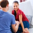 Young girl with boyfriend relaxing at home — Stock Photo