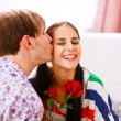 Happy girl get rose as present from her boyfriend — Stock Photo