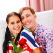 Cheerful couple in love enjoying themselves at home — Stock Photo