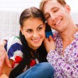 Happy young couple speaking together on cell phone — Stock Photo