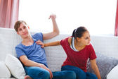Young couple quarreling at home — Stock Photo