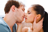 Romantic young couple having kiss — Stock Photo