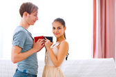 Young couple exchanging gifts — Stock Photo