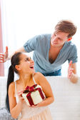 Happy young woman looking on boyfriend who made her surprise — Stock Photo