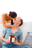 Young woman present gift to her husband — Stock Photo