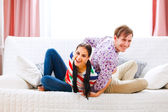 Happy young couple having fun at home — Stock Photo