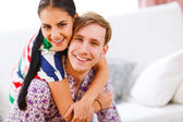 Portrait of smiling young couple — Stock Photo