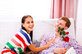 Cheerful young couple having fun time at home — Stock Photo