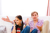 Young man dissatisfied with long time talking on phone girlfrien — Stock Photo