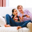 Young happy couple playing console — Stock Photo #8630017