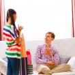 Young man helping her girlfriend to choose dress — Stock Photo #8630028