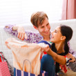 Young guy helping her girlfriend to choose dress — Stock Photo #8630029