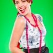 Portrait of cheerful beautiful girl with red  jewelry. Pin-up and retro sty - Stock Photo