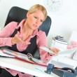 Stock Photo: Sitting at office desk business woman dissatisfied with bad results of work