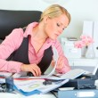 Stock Photo: Hard working on documents modern business woman