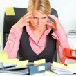 Tired business woman sitting at workplace overwhelmed with sticky reminder — Stockfoto