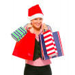 Happy female business secretary in Santa Hat with shopping bags — Stock Photo