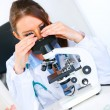 Woman researcher using microscope in medical laboratory. Close up — Stock Photo