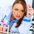 Thoughtful doctor woman in laboratory analyzing results of medic - Stock Photo