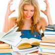 Frustrated teen girl with lots of books tired of studying — Stock Photo